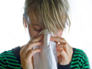 woman-blowing-nose
